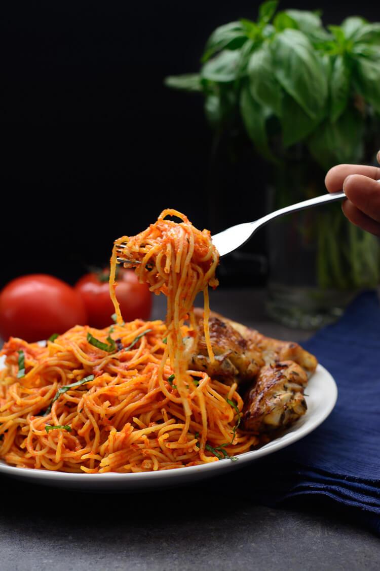 Jollof Spaghetti - taking a delicious bite