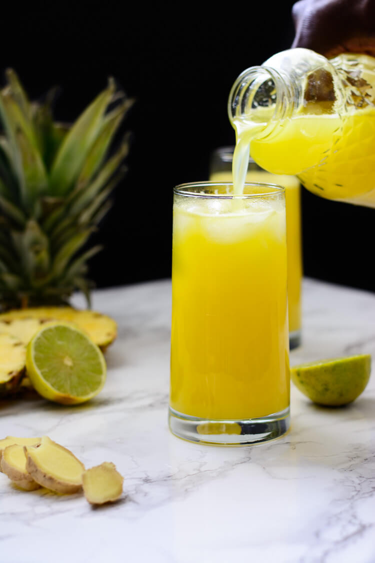 Pineapple Ginger Juice: Healthy homemade - pouring a nice, healthy, helping of juice into a glass