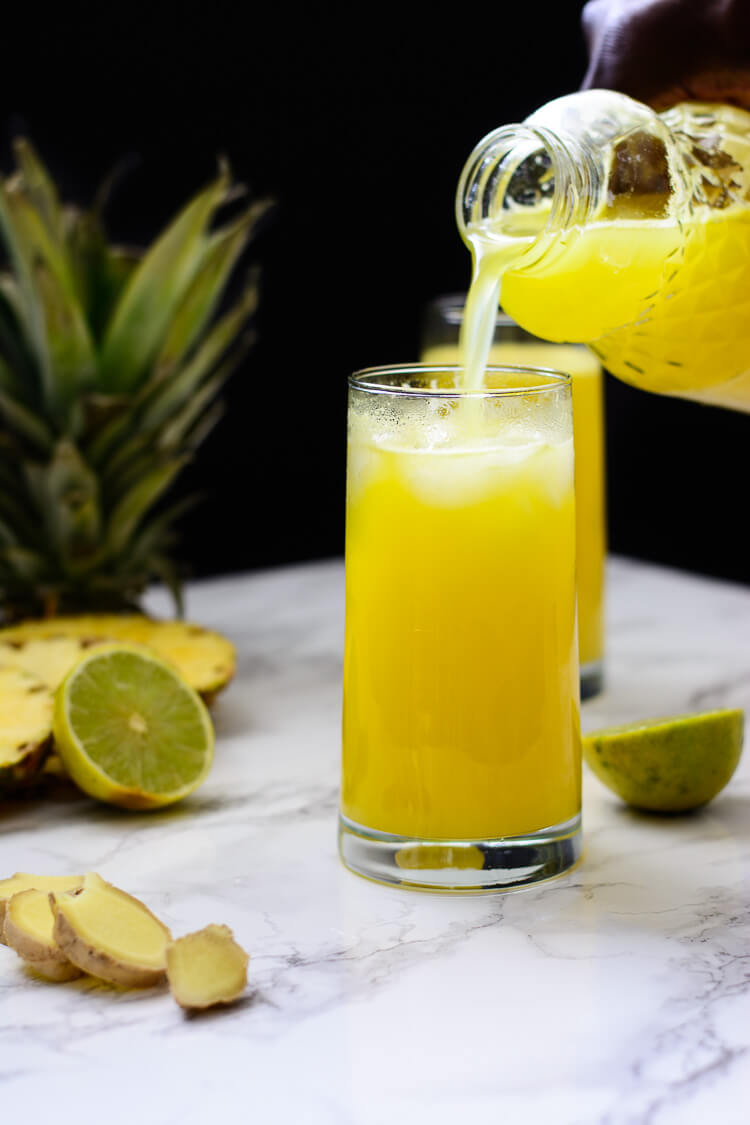 Pineapple Ginger Juice: Healthy homemade - pouring a nice helping of juice into a glass