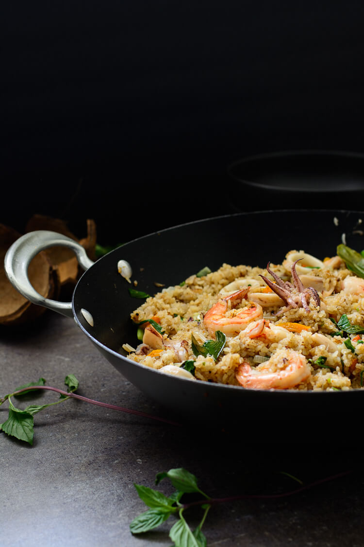 side shot of mixed seafood coconut fried rice in skillet