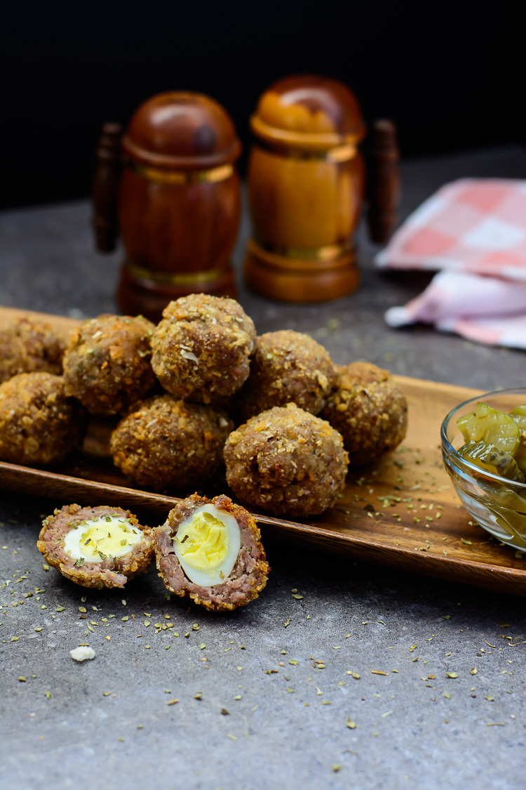 Scotch Quail Eggs with Homemade Sausage - scotch quail eggs on a platter