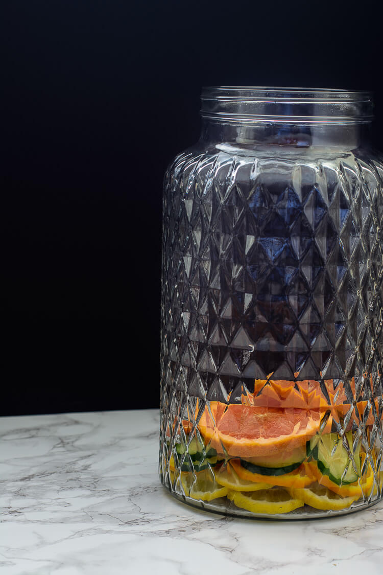 Nigeria's Favorite Mocktail: Chapman Drink - Fruits in a glass dispenser