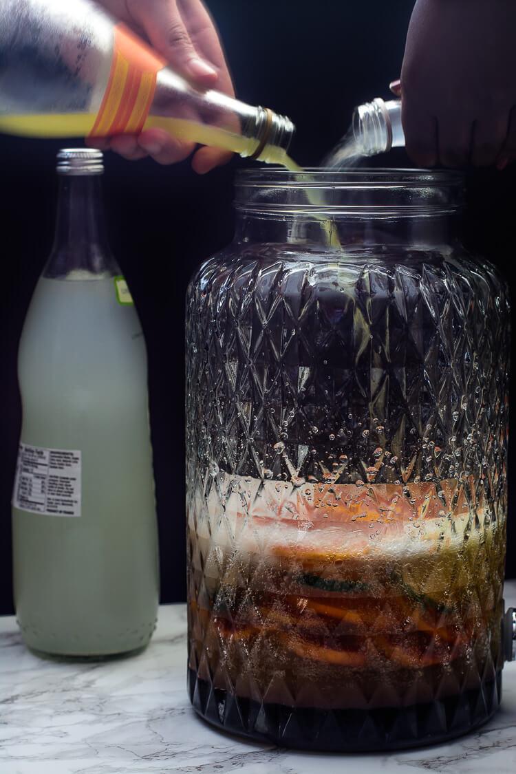 Nigeria's Favorite Mocktail: Chapman Drink - pouring the orange soda