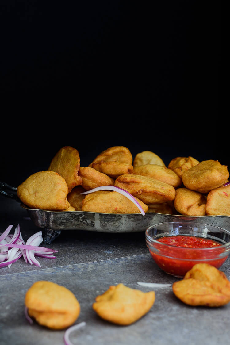 Nigerian Akara Recipe (Accara/Acaraje): Black Eyed Pea Fritters - side shot with spicy tomato sauce