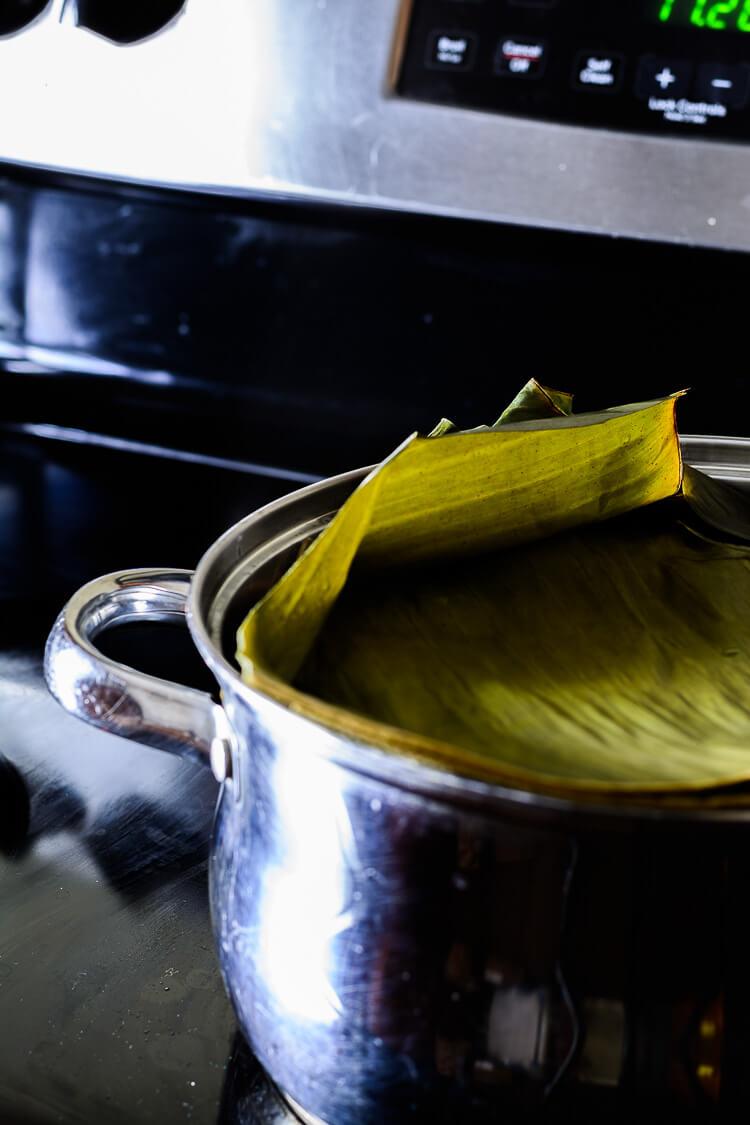 Moin-Moin/Moi Moi Recipe: Steamed Black Eyed Peas Pudding - banana leaves covered pot on the boil