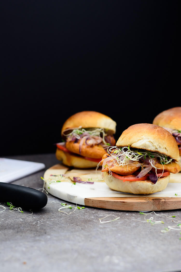 Akara Burger - Using bread rolls to make a burger with caramelized onions, tomatoes, sprouts, akara