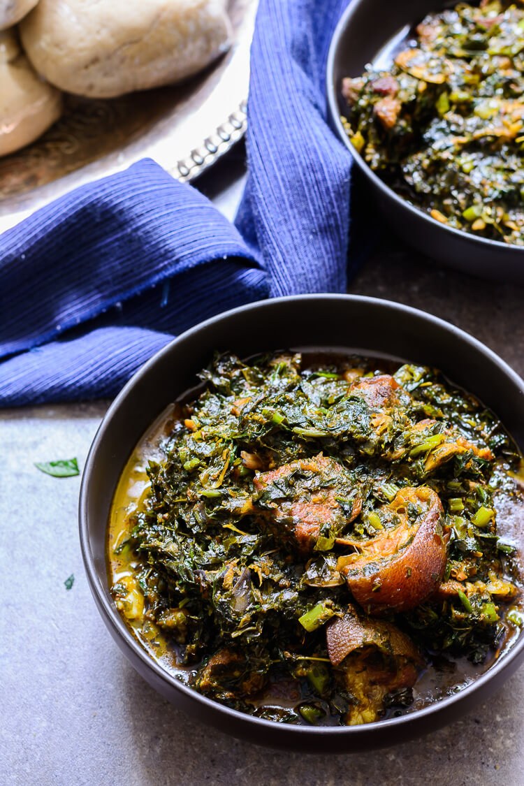 Nigerian Afang Soup: A Delicious Ibibio Vegetable Stew - Overhead shot of two servings of afang soup with oat meal on the side