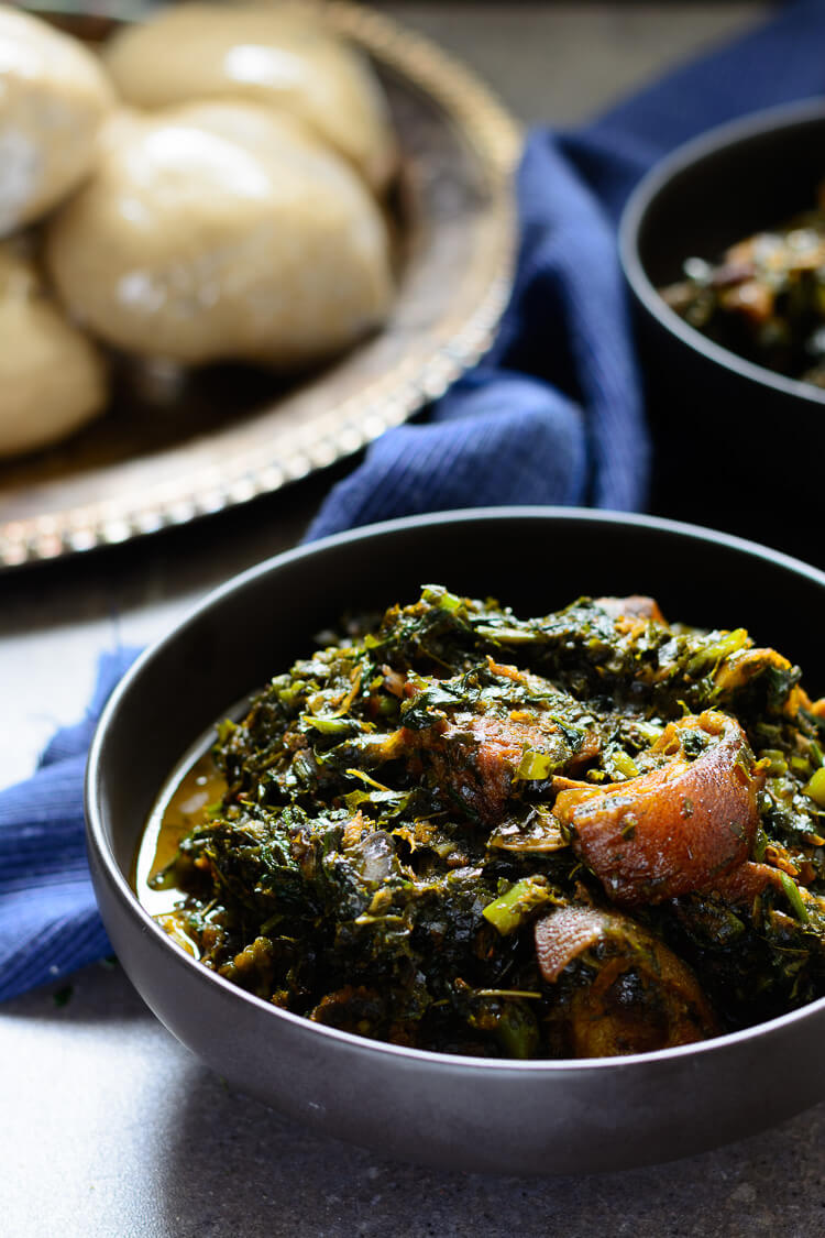 Afang soup in bowl served with oatmeal swallow