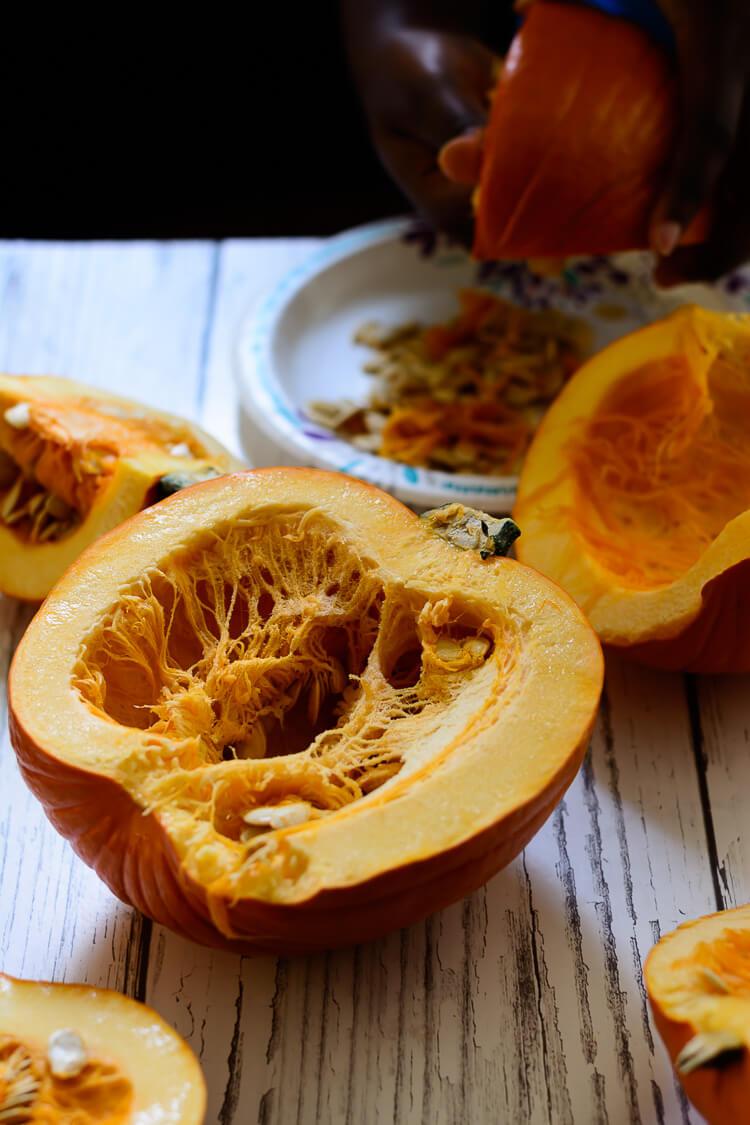 Homemade Pumpkin Puree from Scratch - close up of a pumpkins cut open