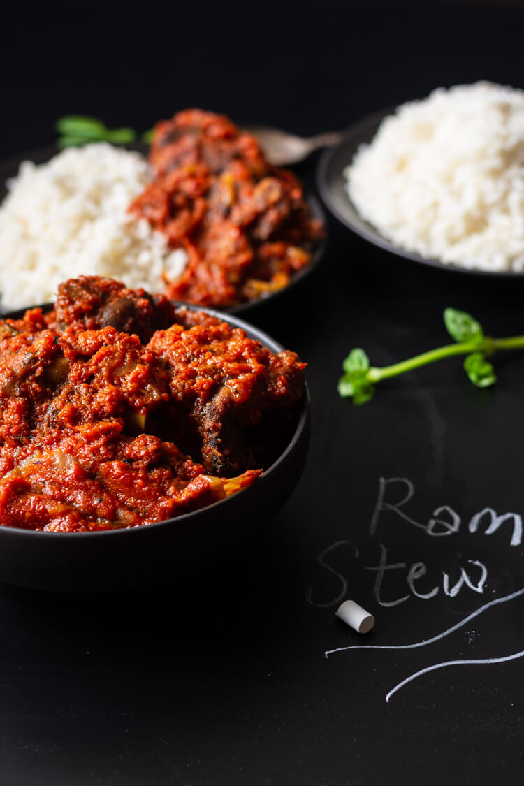 Bowls of Nigerian Red Stew with Ram Meat and rice