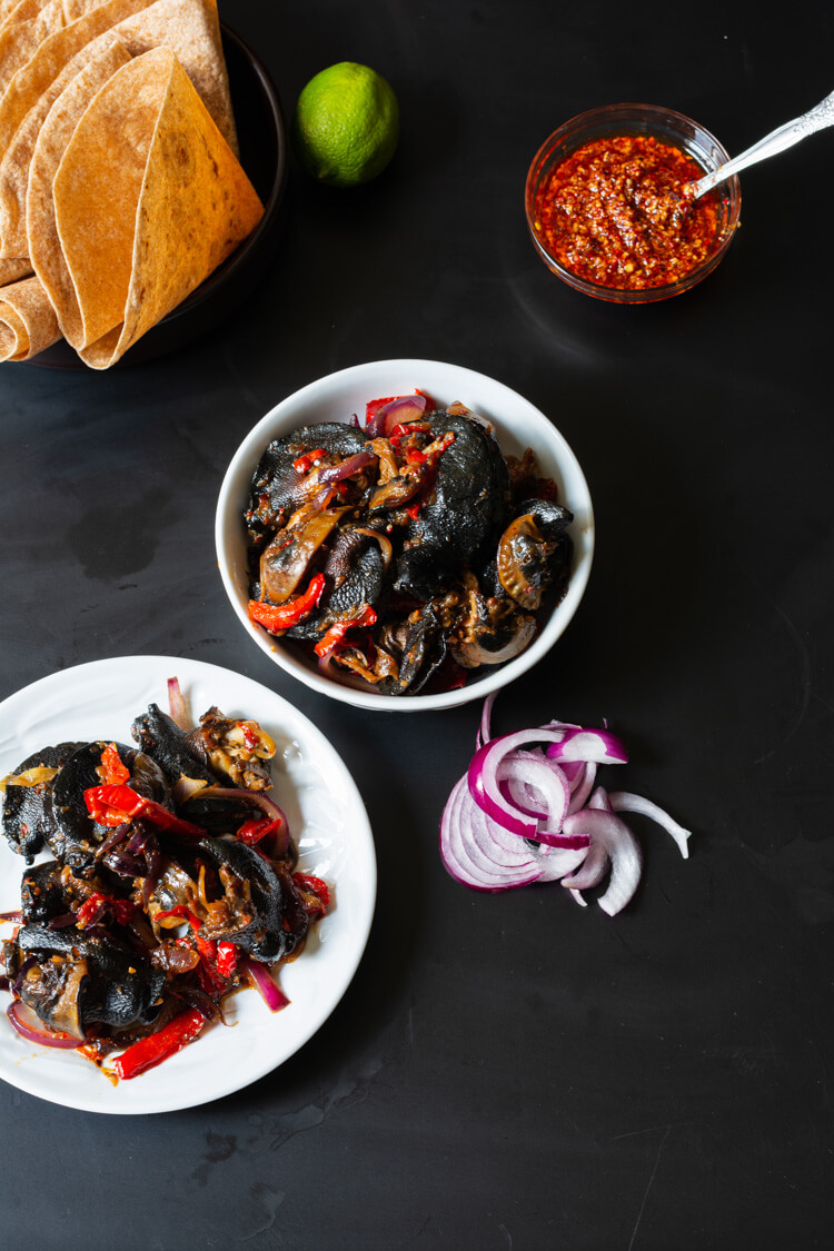 top view of spicy Nigerian snail dish served on plates