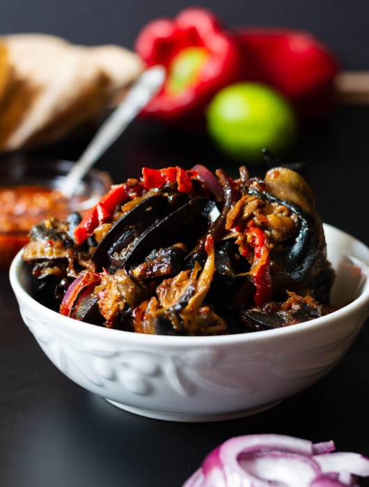 Close up shot of the spicy Nigerian peppered snail dish in bowl
