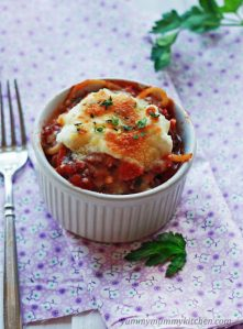 Easy spaghetti pie recipe baked in a ramekin and topped with ricotta and mozzarella cheeses.