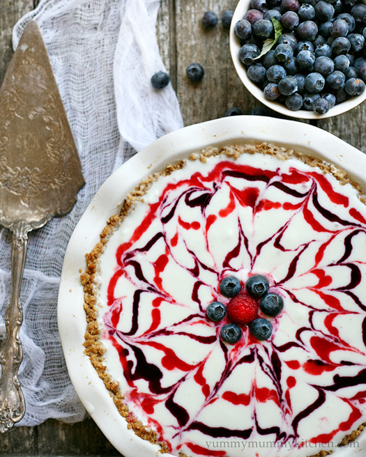 This beautiful ice cream pie is made in a granola crust and topped with berry sauces. It's the perfect festive dessert for Memorial Day, Fourth of July, or any summer occasion.