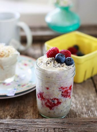 A jar of overnight oatmeal with fresh berries.