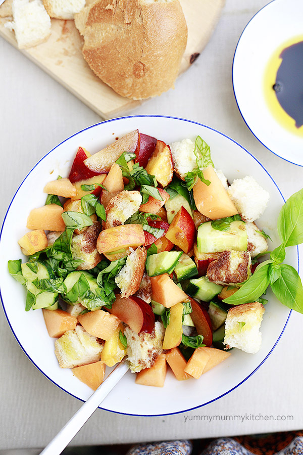 Stone fruit panzanella with Italian bread, fresh basil, cucumber, and balsamic is the marriage of several of Italy's best summer ingredients all in one bowl.