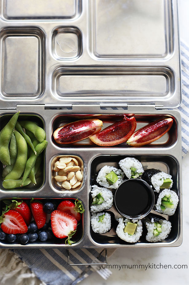 A healthy vegetarian and vegan kids' lunch in a planetbox with sushi.