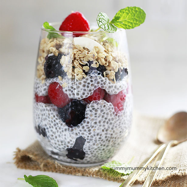 A glass with basic chia pudding, berries, and granola.