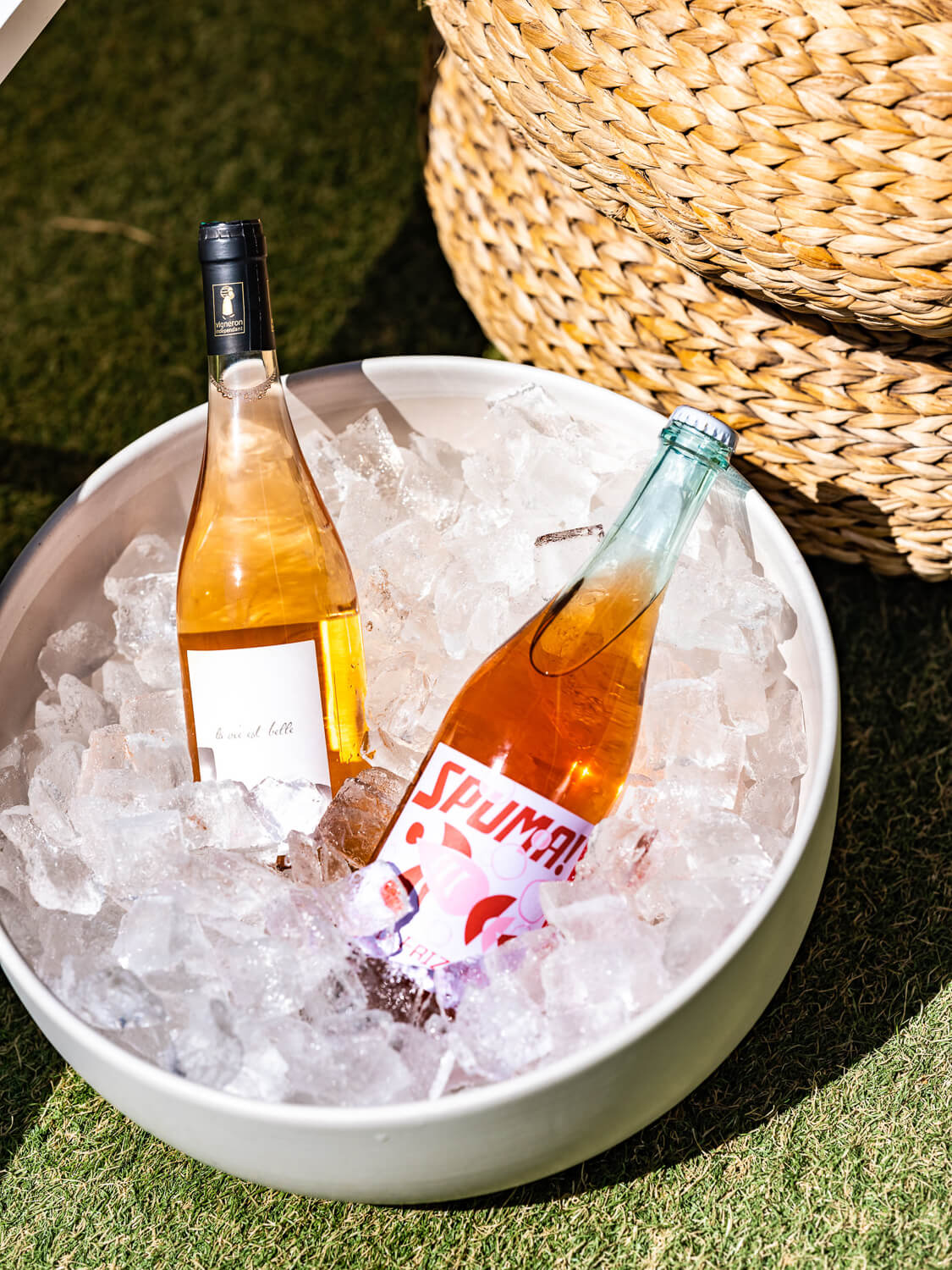 Two bottles of rose wine from Dry Farms Wine in an ice bucket.