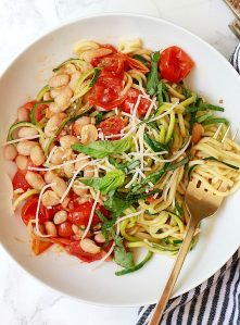 Zucchini noodles with white beans and tomatoes.