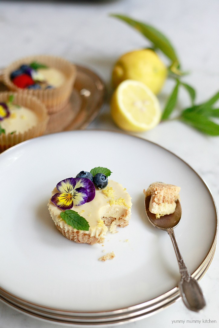 Pretty vegan tarts that taste like lemon bars and cheesecake. Topped with edible flowers and berries.