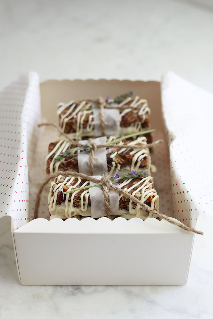 A gift box filled with peanut butter granola bars with cranberries, macadamia nuts, and white chocolate.