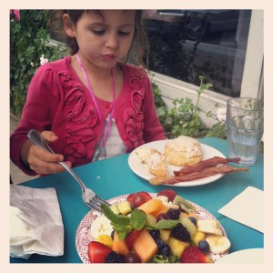 A little girl eating breakfast at Jeannine's restaurant in Santa Barbara, CA.
