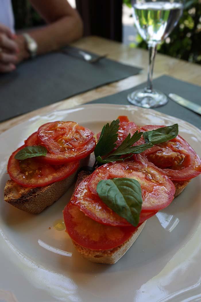 Simple tomato bruschetta served in a restaurant in Radda in Chianti.