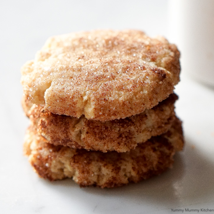 These soft almond flour snickerdoodle cookies are done in under 20 minutes! They are naturally vegan and gluten-free.