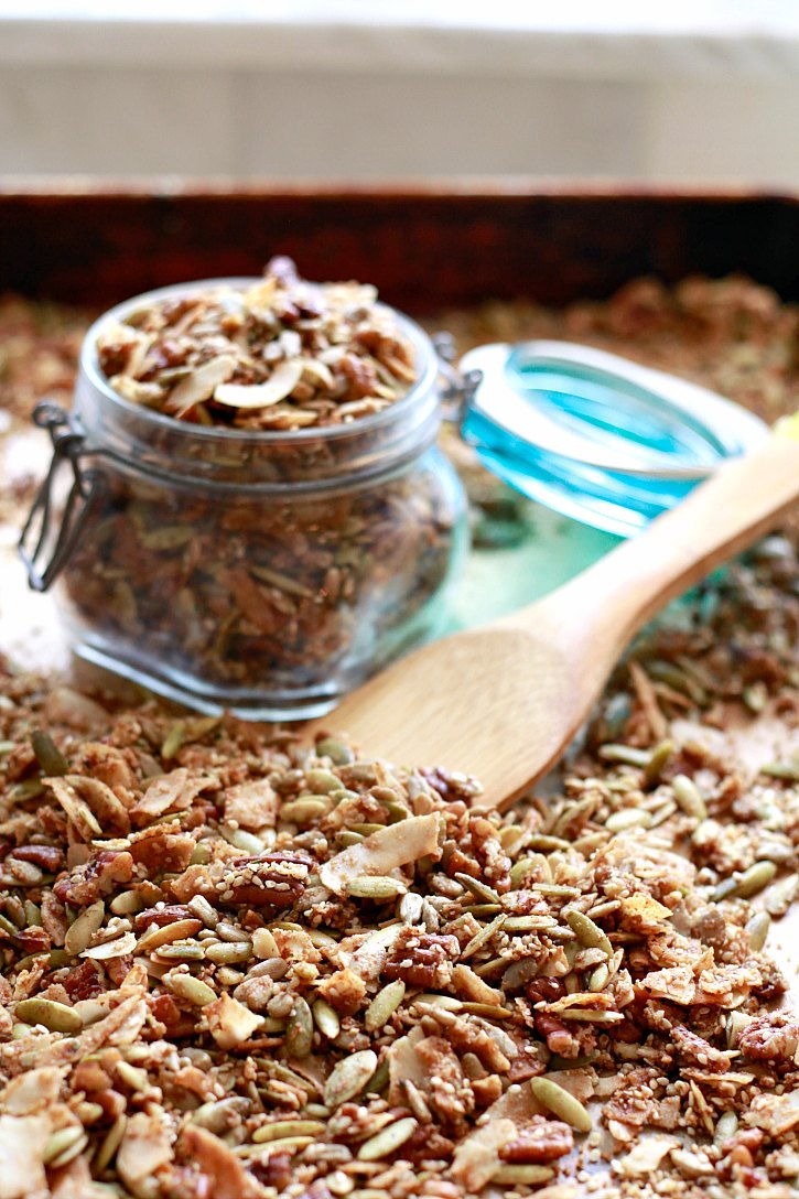 Making paleo, vegan, grain-free granola with seeds, nuts, and coconut oil is easy! Store it in a jar or give as a DIY gift.