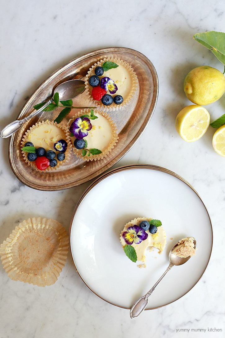 Beautiful paleo and vegan tarts topped with fruit and edible flowers.
