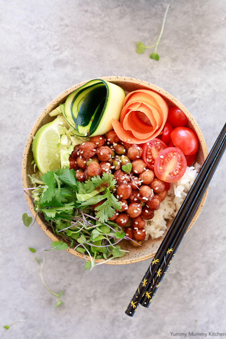 A buddha bowl filled with BBQ chickpeas, rice, and vegetables.