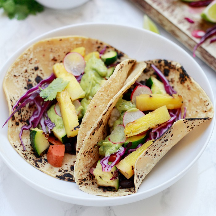 Beautiful veggie and black bean tacos with avocado cream sauce.