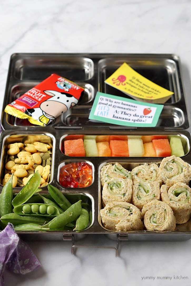 Planetbox lunch box with cucumber cream cheese sandwiches, Horizon Organic snacks, and printable jokes for kids.
