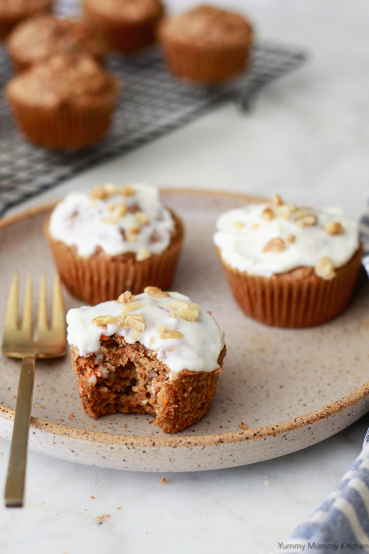 Healthy carrot muffins made with oat flour and topped with a cream cheese frosting. These blender carrot muffins are vegan and gluten free.