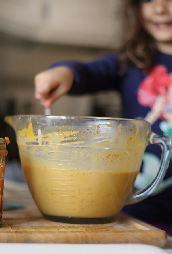 The ingredients for pumpkin pie get stirred together in a bowl.