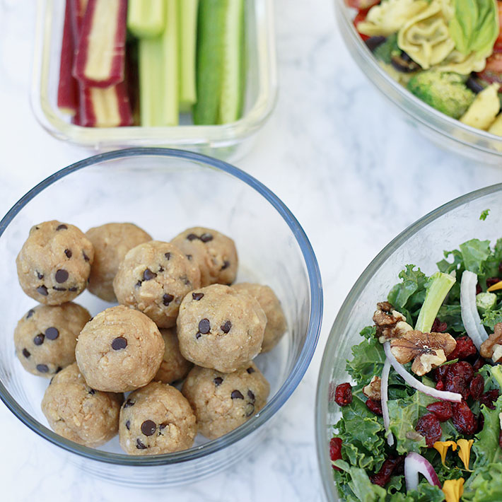 Healthy vegan meal prep ideas include energy balls, salad, pasta salad, and cut veggies.