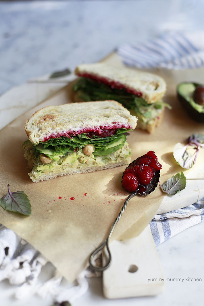 smashed chickpea and avocado sandwich with cranberry sauce makes a tasty vegetarian and vegan Thanksgiving sandwich