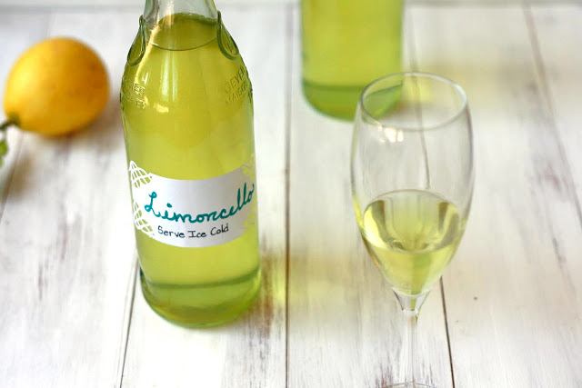A glass bottle filled with homemade limoncello.