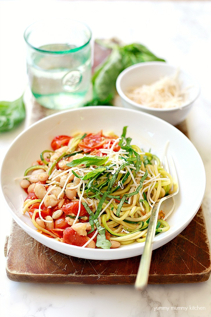 One pot vegan zucchini noodles with white beans, roasted cherry tomatoes, garlic, and basil.