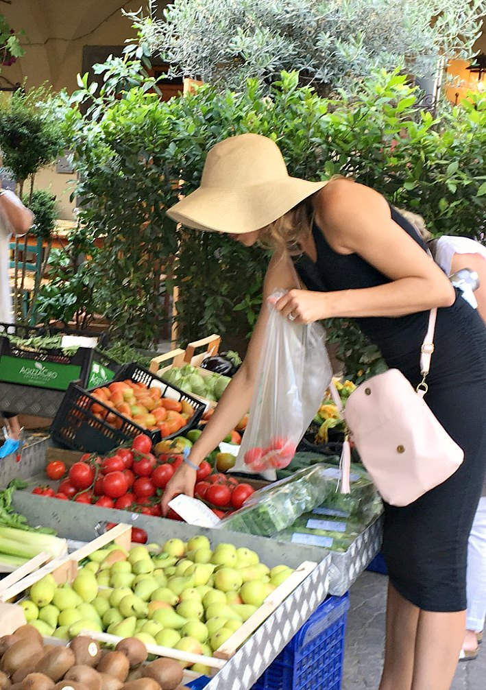 Shopping for produce at the farmers market in Greve in Chianti, Italy.