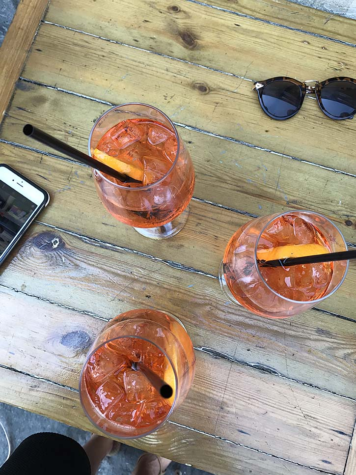 Orange Aperol Spritzes on a table in Florence