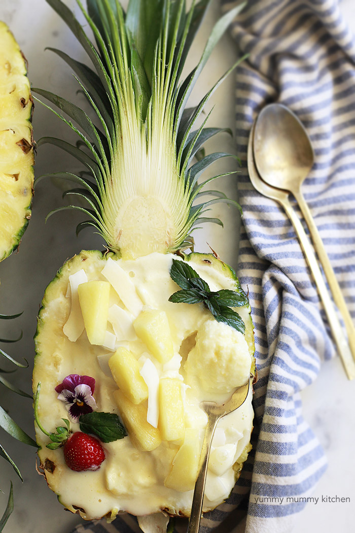 A pineapple boat filled with creamy vegan pineapple ice cream.