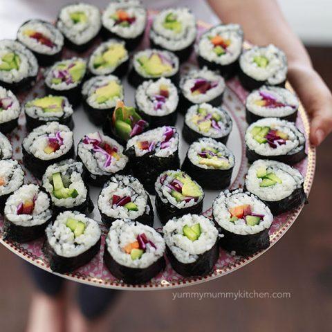 A large platter filled with vegan sushi rolls.
