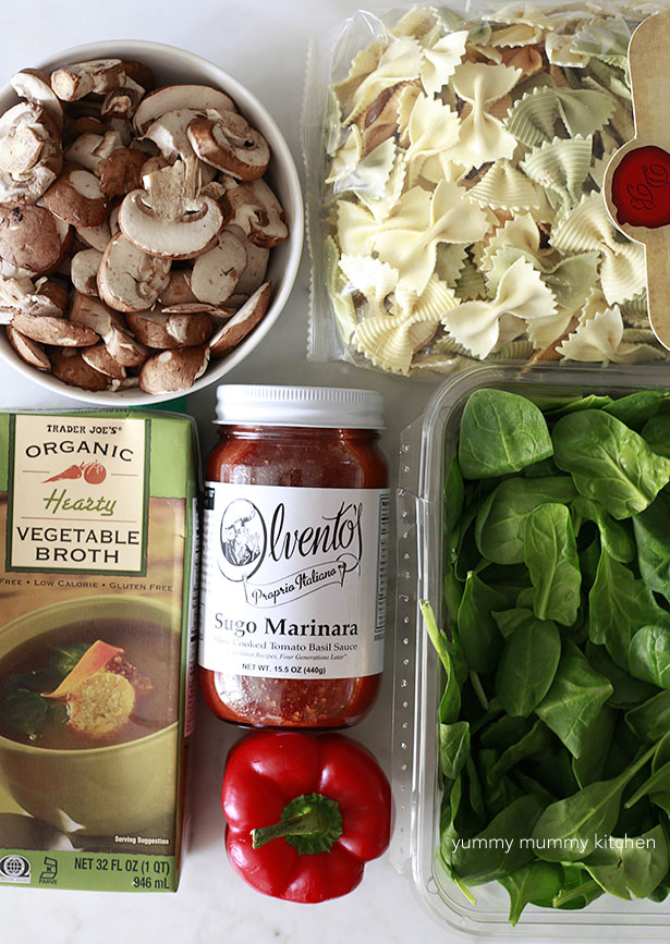 Easy Lasagna Soup ingredients include fresh spinach, pasta, mushrooms, bell pepper, and vegetable broth.