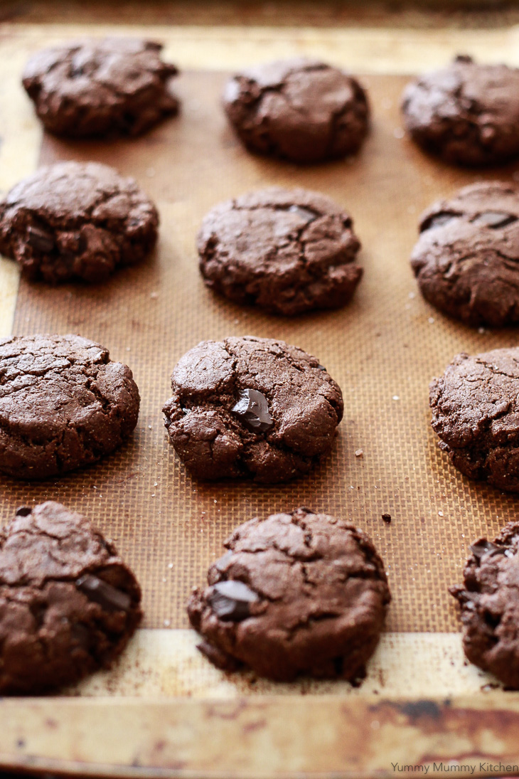A sheet of freshly baked double chocolate almond flour cookies. These delicious cookies are vegan, paleo, and gluten-free.