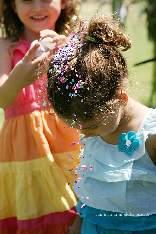 Girls cracking confetti eggs during Fiesta in Santa Barbara