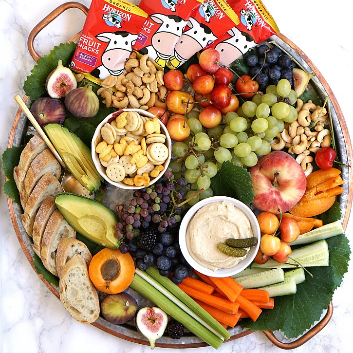 Ideas for putting together an easy, beautiful, and wholesome snack platter that all ages will love. The ingredients listed below are perfect for summer entertaining, but feel free to use different ones depending on the season.