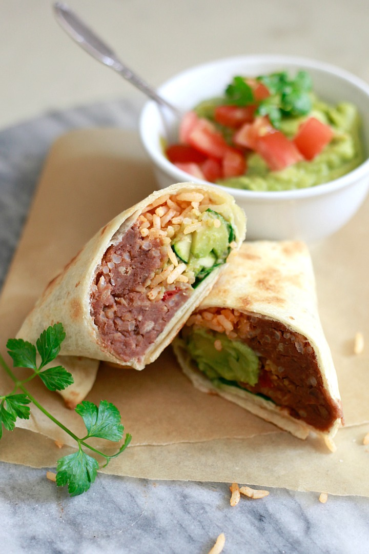 A bean and rice burrito served with guacamole is a great option for vegan meal prep.