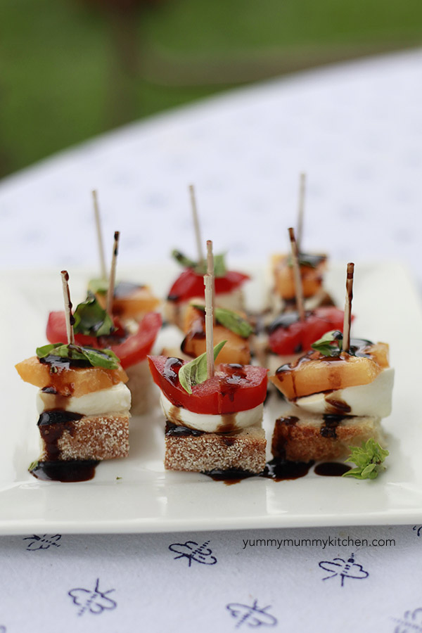 Caprese Bruschetta Bites with heirloom tomatoes and balsamic are the perfect appetizer for parties.